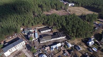 Flight Over Buildings Near Forest 3
