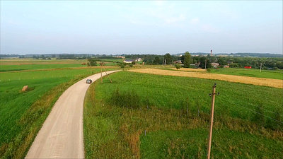 Aerial View, Car Driving On Gravel Road In Country 1
