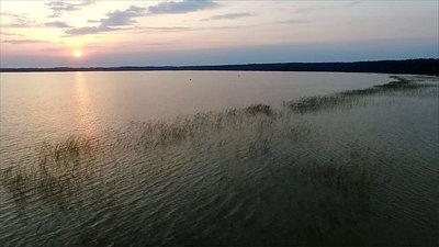Rising Up From The Beach On Lake, Sundown