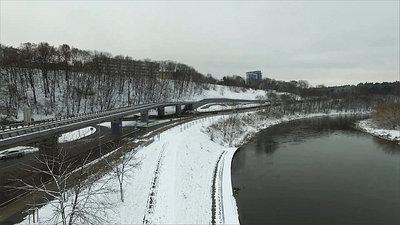 Slow Landing Near River In City, Winter