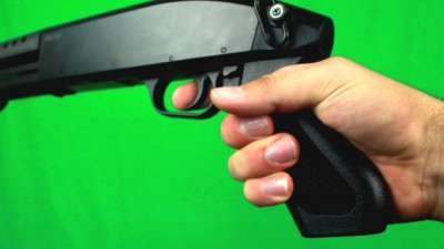 Putting Finger On A Trigger And Holding Shotgun