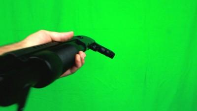 Giving A Shotgun While Holding A Barrel Left Side