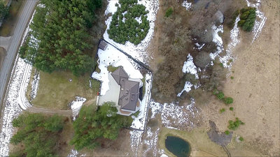 Vertical Flight Over House With Rotation
