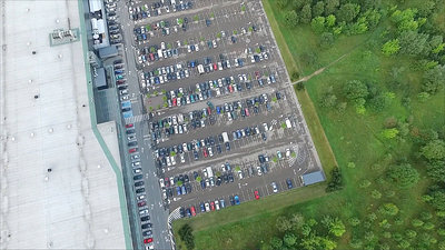 Aerial View Over Parking Near Supermarket 1