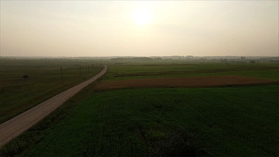 Flight Beyond Gravel Road In Countryside With Rotation