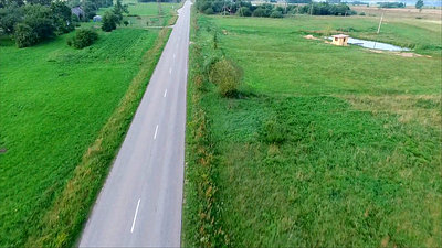 Flying Over Country Road And Rising Up