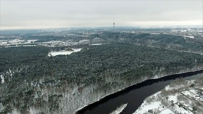 Aerial View Over The City Near River And Forest, Winter