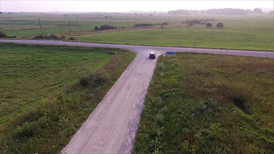 Aerial View, Car Leaving Gravel Road In Country