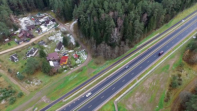 Flight Over The Highway, Forest And Houses